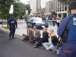 Peaceful citizens guarded by armed U.S. Marshals.