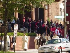 Clergy leave the church at the conclusion of the Red Mass.